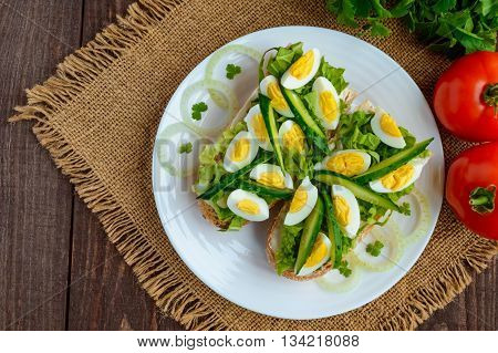 Fresh green sandwich with fresh cucumber Chinese cabbage quail egg. Dietary and vegetarian dishes. The top view