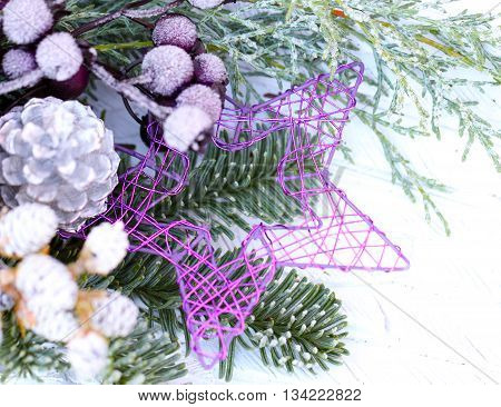 purple metal star with pine green and Christmas decoration
