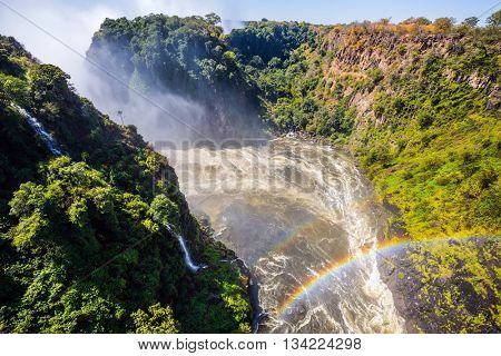 After the rainy season, the waterfall most high water. The famous Victoria Falls on the Zambezi River in South Africa