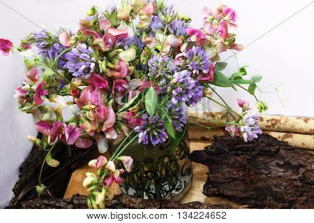 Summer bouquet of sweet peas and bituminarias