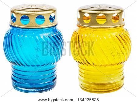 Blue and yellow votive candles isolated on white background with clipping path. Cemetery candles.