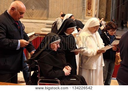 Rome Italy - APRIL 10 2016: Thousands of nuns and priests are visiting St. Peter's Basilica in the Vatican every year as pilgrims.