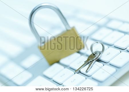 Security lock on white computer keyboard - computer security breach concept