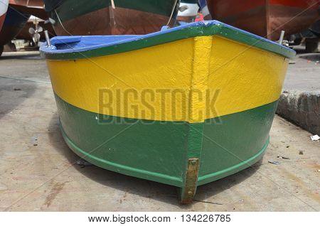 Newly painted yellow and green fishing boat at Camara de Lobos in Madeira Portugal