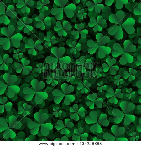 Vector seamless pattern with green shamrock leaves on a black background.
