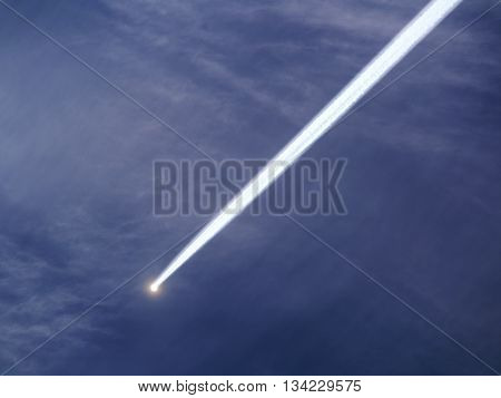 flying smoky meteor on background of sky