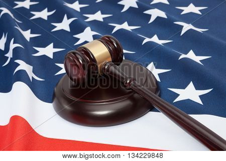Close Up Shot Of A Judge Gavel Over United States Flag