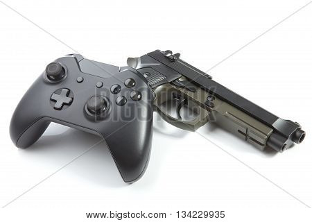 Game Controller With Real Handgun Near It