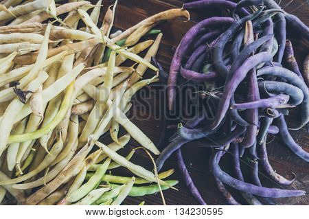 Yellow And Purple String Beans In Their Pods