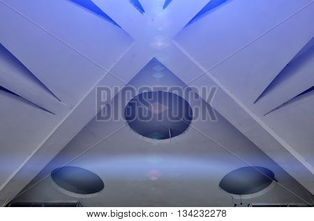 Closeup of architecture elements of stone ceiling. Architecture urban minimalist view of architecture ceiling details with stylized reflected futuristic light