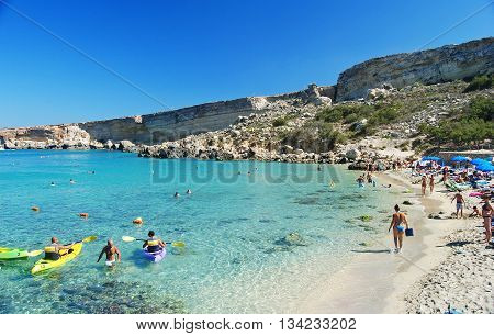 Paradise Bay, Malta - September 28, 2013. Paradise Bay on the Marfa Peninsula in Malta, with people.