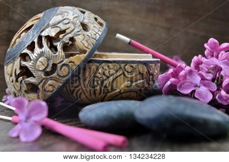 incense burner with sticks lilac perfume on wooden background