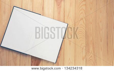 open notebooe on brown wooden table for background the blank space on the right for text