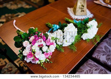 Groom and groomsman wedding bouquets at wedding day