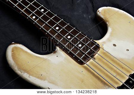 Electric bass guitar closeup focus on strings