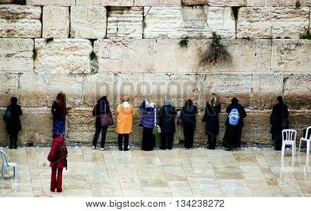 Group of jewish women pray at the Western Wall in Old City in Jerusalem, Israel
