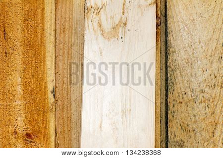 Plank (board) of wood. Old and cracked. The surface is rough and uneven.