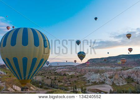 Hot air balloon flying over Cappadocia region Turkey