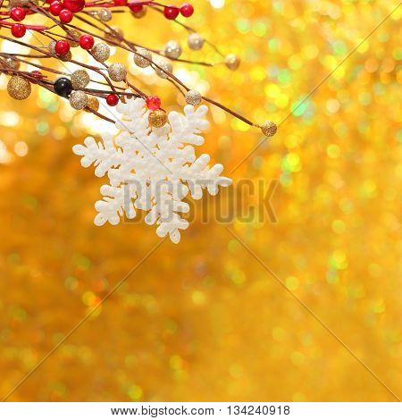 Christmas background with snowflake red berry and golden bokeh