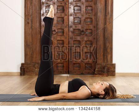 Woman Yoga Trainer In Asana