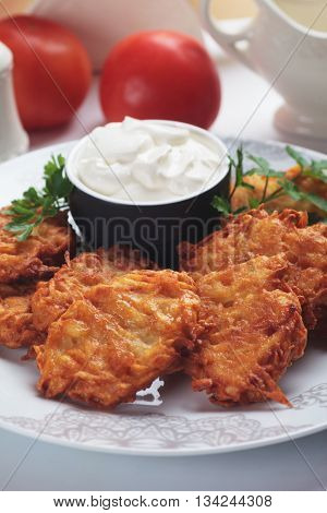 Latke, jewish potato pancakes served with double cream