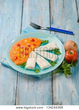 steamed cod with capsicum cream, selective focus