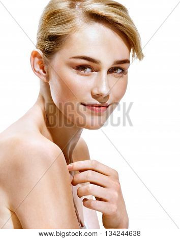 Beautiful blonde girl. Close up of an attractive girl of European appearance on white background. Youth and skin care concept