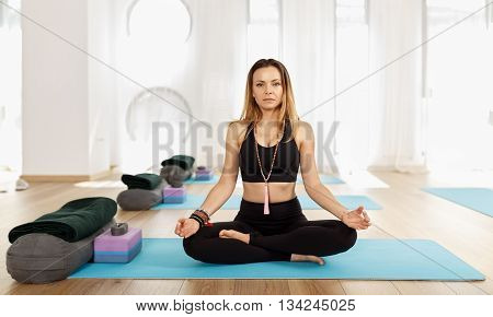 Woman Yoga Trainer In Asana