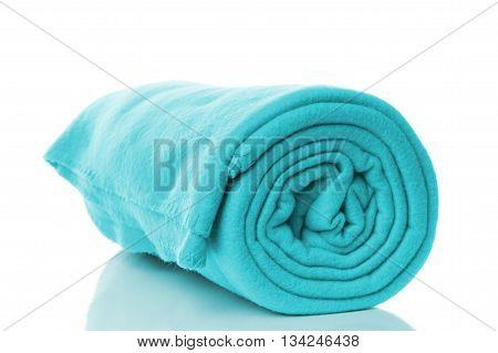 turquoise or cyan fleece blanket on white