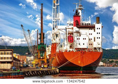 Cargo ship moored at the quayside in the port of Gdynia Poland.