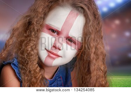 Soccer fan little smiling girl portrait with flag of England on face