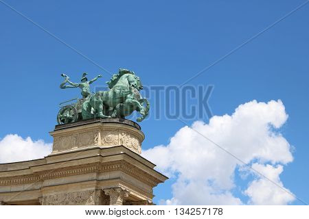 Man with a snake a symbol of war at the Millennium Monument of the Hero Square Budapest Hungary