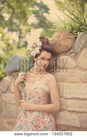 Portrait of vintage woman. The girl in the dress of the last century. Beautiful woman in long evening dress. Fairy Princess. Toned