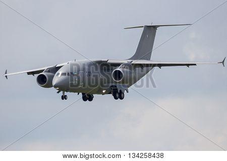 BERLIN - JUN 2 2016: Antonov An-178 short-range medium-airlift military transport plane landing on Berlin-Schoneveld airport