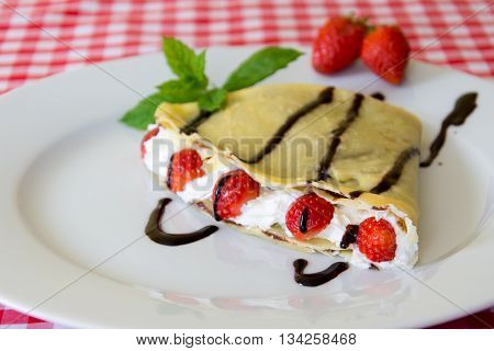 Sweet Crepe With Chocolate And Fruit