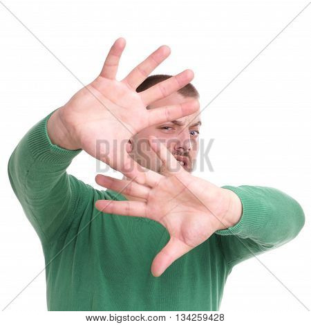 disgusted young man with raised hands isolated on white