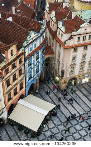 PRAGUE, CZECH REPUBLIC - 10, JANUARY 2016: view over the colorful old houses and red tiled roofs from the top of Staromestska tower in the old center of Prague, unknown people. Shot in winter of 2016