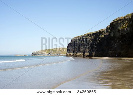 ballybunion beach and cliffs on the wild atlantic way at low tide