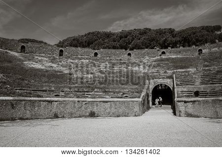 Ancient Arena of the Amphitheatre in Pompeii, Italy. A monochrome image, black and white.