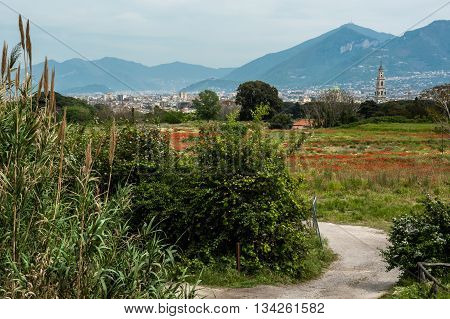 Pompeii: panoramic view from ancient city into the new town. The surrounding area of Pompeii, Italy. Panoramic view from the outskirts of the ancient city of Pompeii into the modern city.