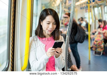 Woman use of mobile phone in train compartment
