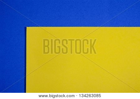 Eva foam ethylene vinyl acetate smooth lemon yellow surface on blue sponge plush background