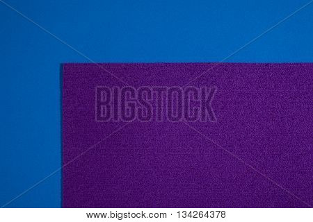 Eva foam ethylene vinyl acetate sponge plush purple surface on blue smooth background