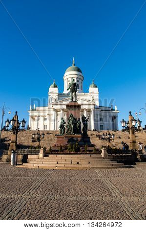 HELSINKI, FINLAND - circa MARCH 2016: St. Nicholas Church and a monument of Alexander II on the Senatorial area in Helsinki, Finland.