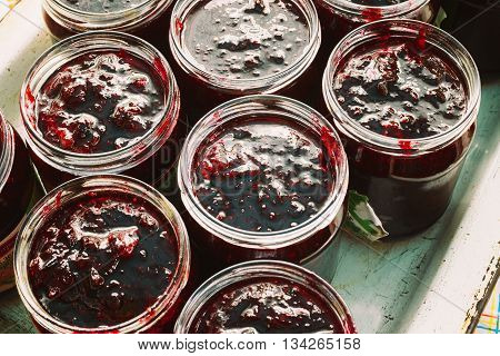 Close Up View Of Jars With Sweet Tasty Yummy Red Jam