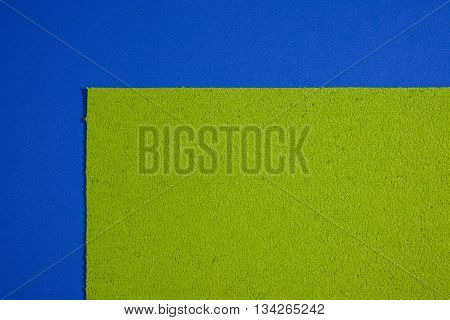 Eva foam ethylene vinyl acetate sponge plush apple green surface on blue smooth background