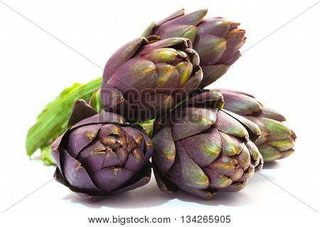 Ripe artichokes close-up on a white background. Isolated object.