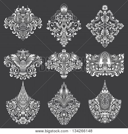 Set of ornamental elements for design. White floral decorations on black. Isolated tattoo patterns in vintage baroque style.