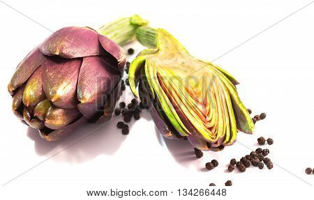 Two ripe artichokes closeup on a white background. Isolated object.