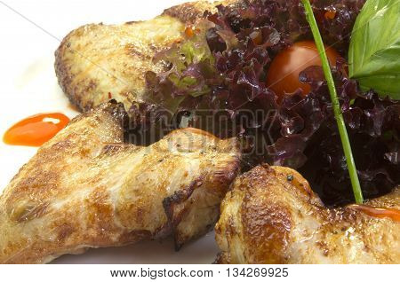 food fried chicken and garnish on a white background